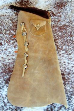 Classically designed Batwing Chaps with Conchos, Bleed Knots and Pocket. Custom made in USA by Cochise Leather.