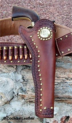 The Scout Slim Jim custom gun holster with border tooling, spots and US Concho. Mady in USA by Cochise Leather.