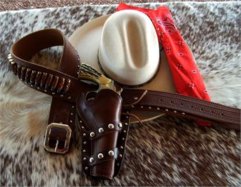 Rio Grande custom made gunbelt and holster with border tooling and spots by Cochise Leather Co. Made in USA.