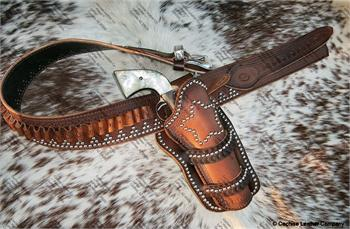 Wild West leather western gunbelt with holster. Border tooled, silver spots and fancy silver buckle, made in USA.