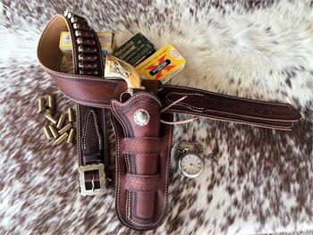 The Drifter gunbelt and holster with fancy tooling, fancy buckle, and concho.