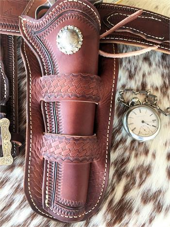 Dakota holster has fancy tooling and antique concho