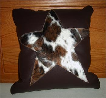 Tricolor cowhide hair-on star is sewn onto solid piece of leather. Back is solid color leather. Pillow is 15' x 15' and one of a kind.