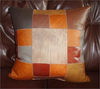 Varying pieces and shapes symmetrically anchored with a large square creates a unique leather pillow.  15' x 15', one of a kind.