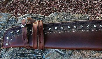 Texas Ranger rifle scabbard is custom made to order with border tooling, double row of silver spots, texas ranger badge. Lined and for lever action rifles only.