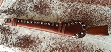 The Pendelton border tooled western rifle scabbard has spots, straps and is fully lined. Custom made in the USA