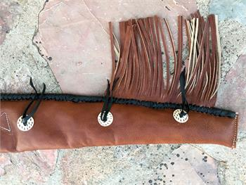 Barrel end of vintage rifle sleeve with hand stitched bottom, bleedknots and fringe