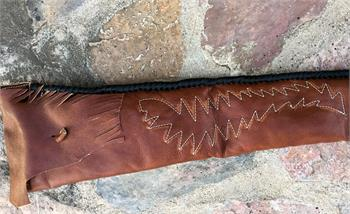 Vintage rifle sleeve, hand stitched, hand laced bottom, end flap closure with leather button