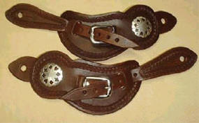 Leather spur straps with poker chip style concho and border tooling