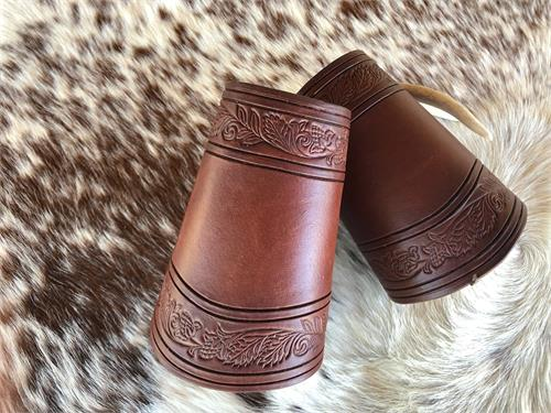Border tooled leahter wrist cuffs for western wear