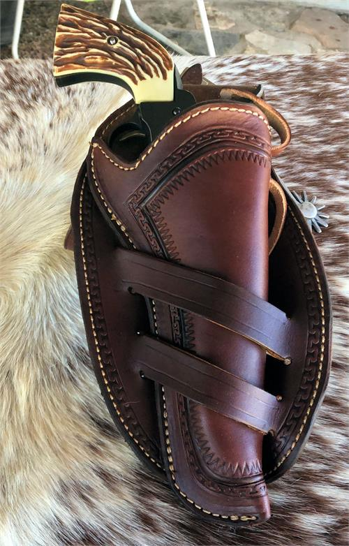Border tooled western gun holster availabe in straight or crossdraw