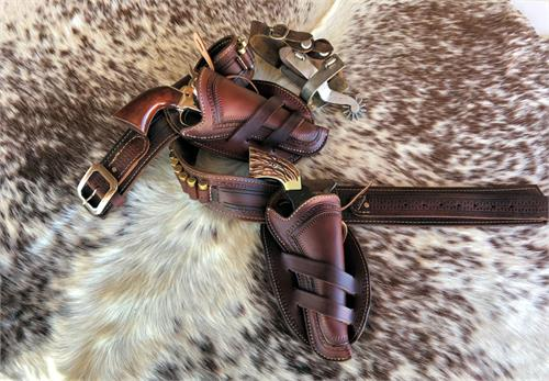 Border tooled gunbelt and holsters in choice of straight or crossdraw