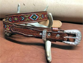 Custom made leather ranger belt features beaded insert, choice of buckles and leather color. Made in USA.