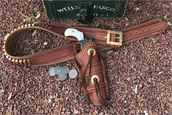 The Sundance gunbelt with holster. Border tooled, conchos, blood knots and fancy buckle.