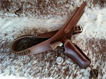 Desperado Buscadero Gunbelt and holster in your choice of plain or border tooled. Fits single or double action pistols.