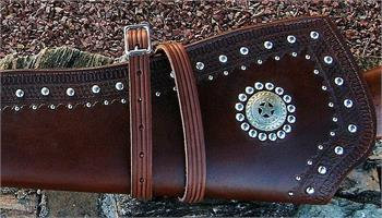 Custom made leather rifle scabbard with border tooling, double row of silver spots, Texas Ranger badge concho with lining.