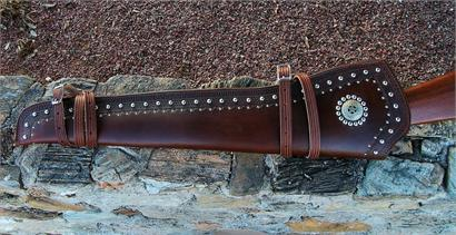 Custom made leather rifle scabbard features border tooling, double row of silver spots, Texas Ranger badge. Lined, for lever action rifles only.