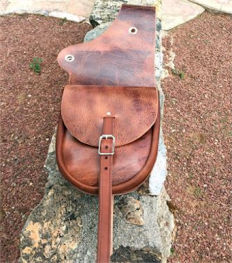 Medium size custom leather western saddlebag with clean, simple styling. Features one strap closure